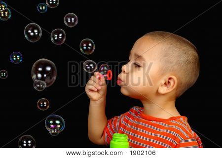 Boy Blowing Soap Bubbles