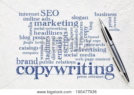 copywriting word cloud  - handwriting on a white lokta paper with a pen