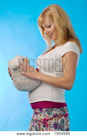 Pregnant Woman With Fur Toy In Hands