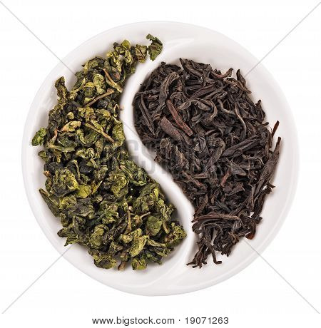 Green Leaf Tea Versus Black One In Yin Yang Shaped Plate, Isolated On White