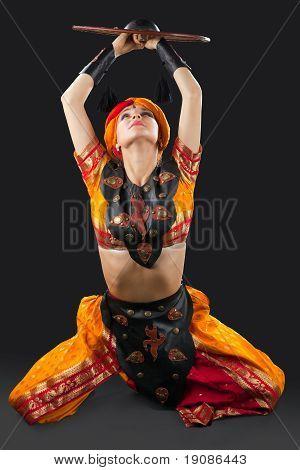 woman oriental dance with shield - arabia costume
