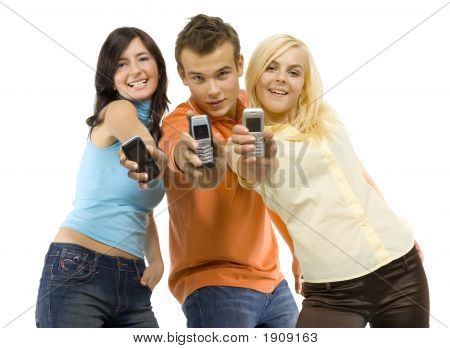 Smiling Teenagers With Mobiles