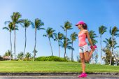 Runner woman stretching leg doing warm-up exercise. Legs stretches exercises before run in summer ci poster