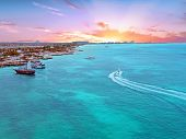 Aerial from Aruba island in the Caribbean Sea at sunset poster