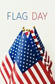 the text flag day and many flags of the United States against an off-white background poster
