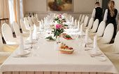Chairs With White Cloth And Table For Guests Served For Wedding Banquet With Flowers. Peony On Dinne poster