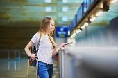 Traveler With Backpack In International Airport At Check-in Counter poster