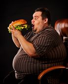 Diet failure of fat man eating fast food hamberger. Happy overweight person spoiled healthy food by  poster