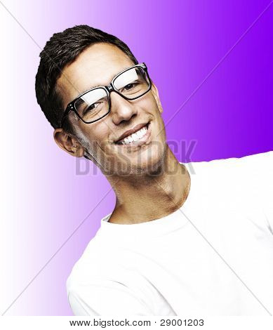 portrait of young man smiling with glasses against a purple background