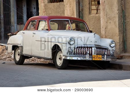 HAVANA-JANUARY 15:Classic DeSoto January 15,2012 in Havana.Before a new law issued on October 2011,cubans could only trade old cars that were on the road before the revolution of 1959