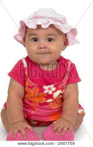 Cute Baby Girl In A Pink Outfit