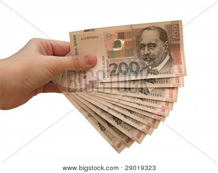 Hand holding croatian money- kuna