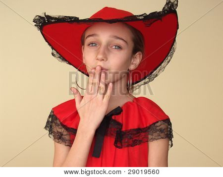 Portrait of a girl in red sending a kiss