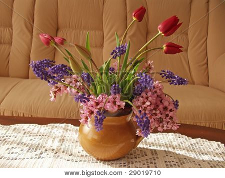 Spring bouquet on a coffee table in the living room