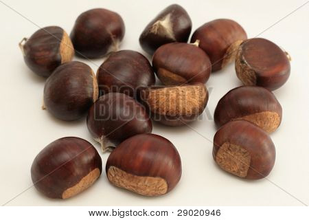 Pile of chestnuts on white