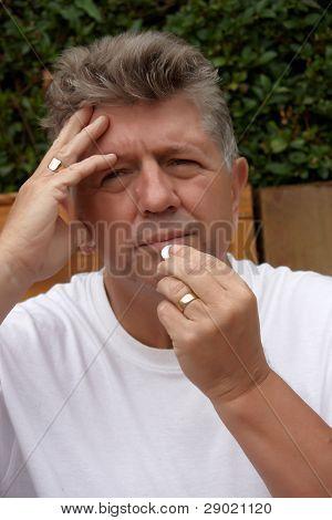Mature Man With A Headache