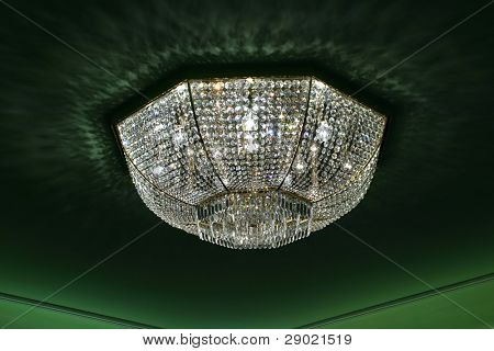 Modern lamp for an interior of a living room on green background