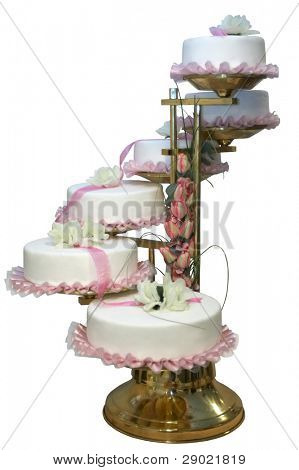 A six tiered wedding cake with white icing and tulips (isolated)