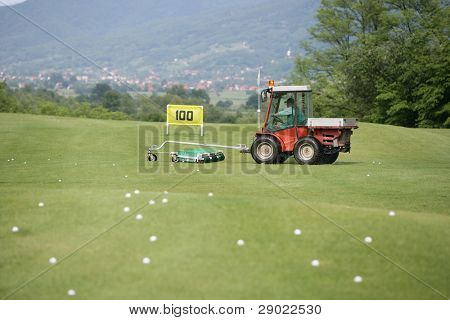 Golf course and a vehicle collecting balls