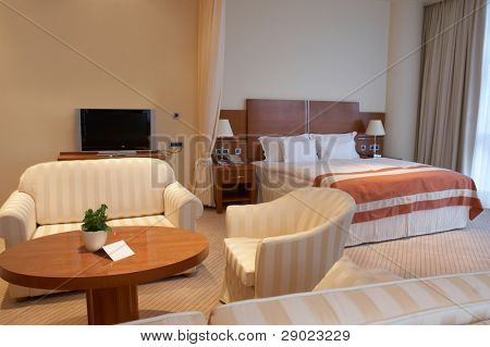 Extravagant and luxurious hotel room (bedroom) in beige