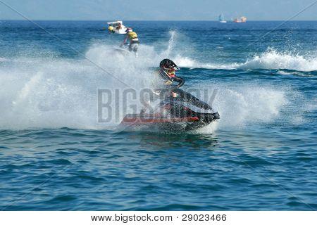 Man speeding on jet ski
