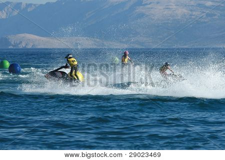 Three men racing on jet ski