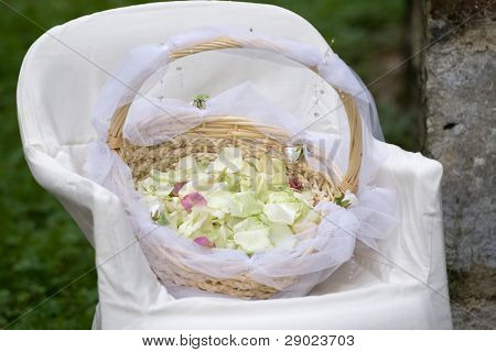 Basket with rose petals on a wedding ceremony