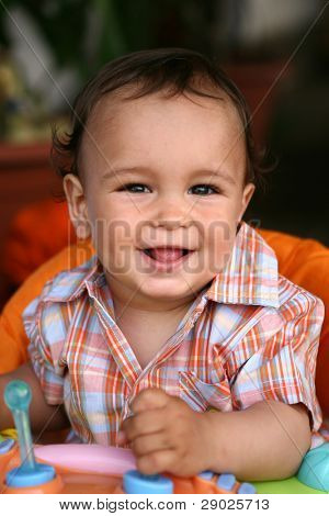 Cute toddler boy smiling