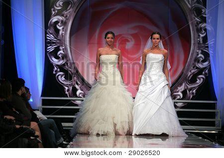 ZAGREB - FEBRUARY 09: Fashion models in wedding dress walking down the runway, February 7, 2009 in  Zagreb, Croatia.