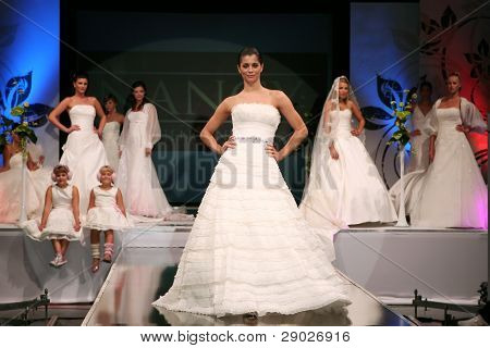 ZAGREB, CROATIA - OCTOBER 3: Fashion model in wedding dress walking down the runway on 'Wedding days' show, October 3, 2009 in Zagreb, Croatia.