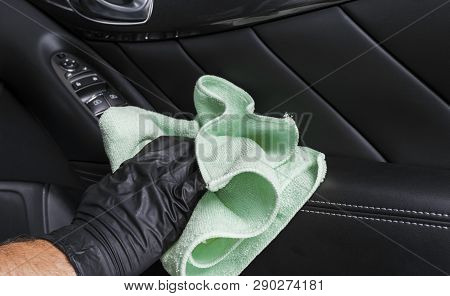 poster of A Man Cleaning Car Seat With Blue Microfiber Cloth. Car Detailing Or Valeting Concept. Selective Foc