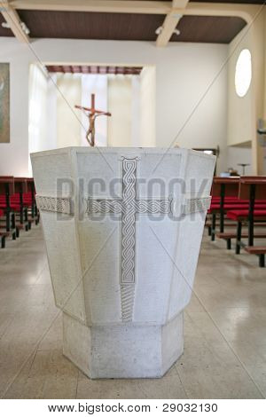 Detail of baptismal font in the church
