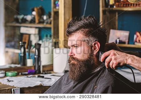 poster of Hands Of Barber With Clipper And Comb, Close Up. Hipster Bearded Client Getting Hairstyle. Barbersho