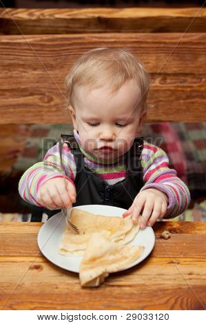 Blond Girl Eating Delicious Pancakes