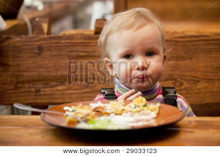 Blond Little Girl In Front Of A Big Plate