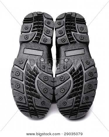 Anti-skid soles on men's winter boots. Isolated on white with natural shadows.