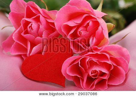 three roses with heart symbol