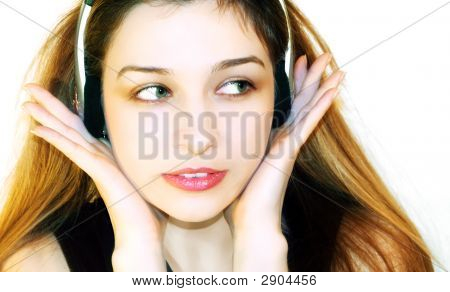 Beautiful Girl Listening Music At Headphones