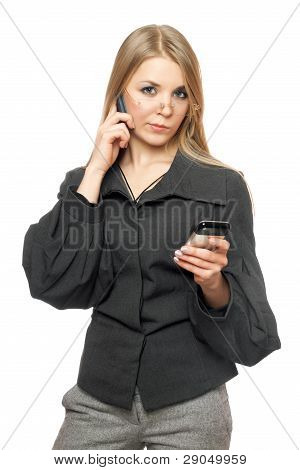Thoughtful Young Blonde In A Gray Business Suit
