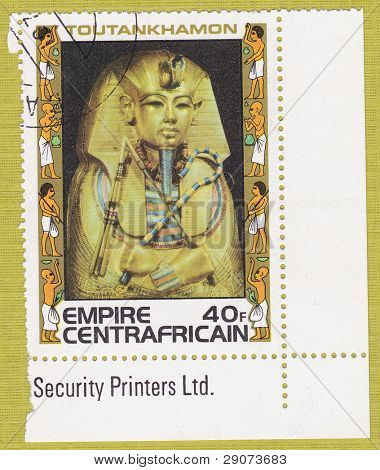 CENTRAFRICAIN - CIRCA 1978: A stamp printed in The Central African Empire showing the image of a burial mask, series is devoted to Egyptian Pharaoh Tutankhamun, circa 1978