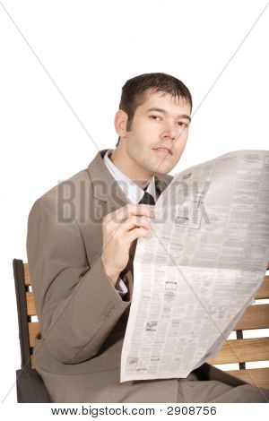 Man Sitting On Bench Holding Newspaper