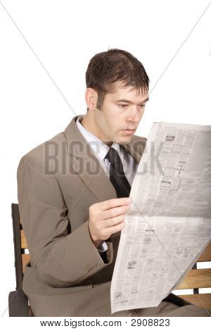 Man Looking At A Newspaper