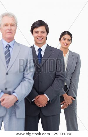 Young businesspeople with their mentor against a white background
