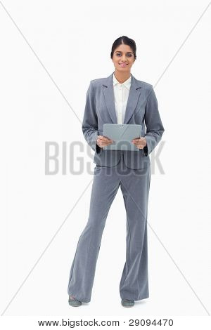 Smiling businesswoman holding clipboard against a white background