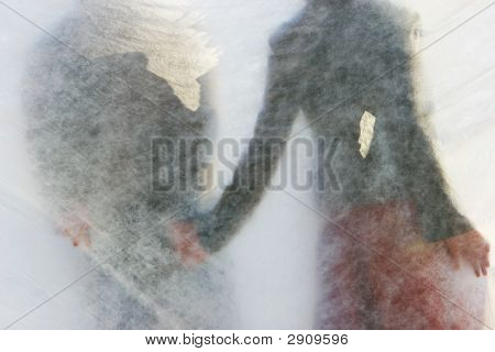 Young Couple Behind Transparent Curtain