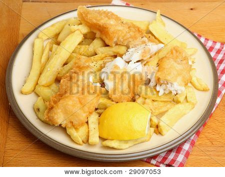 Battered fried fish with chunky chips.