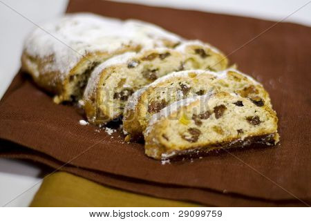 baked cake with raisins on a linen napkin