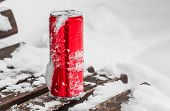 An Opened Red Shiny Bright Tin Can With White Snow On Its Surface With Key For Cool Cold Soft Drinks poster