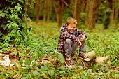 Go Camping With Me. Small Kid Enjoy Camping Trip. Small Boy Sit On Tree. Adorable Kid Relax In Woods poster