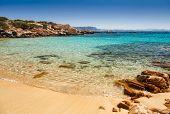 Small Cala Zavagli beach, island of Spargi, Maddalena Archipelago, Sardinia, a popular travel destin poster